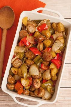 An easy dinner of Italian sausage, bell peppers and new potatoes, cut into bite-sized pieces and roasted with garlic, balsamic vinegar and olive oil.