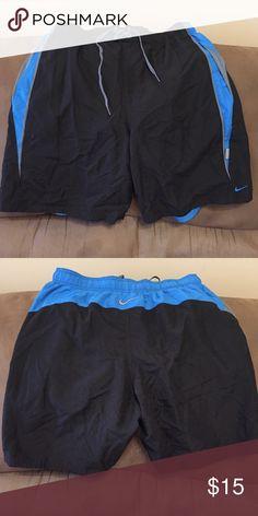 Nike men's swimsuit Men's Nike swimsuit.  Black with blue and grey. Size L Nike Swim Swim Trunks