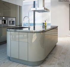 Enjoying the curved doors in modern kitchen design. very nice!