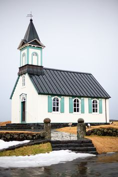 pretty church by the sea with Tiffany Blue shutters!!!  awwwww