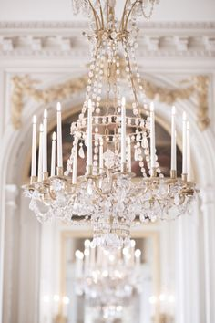 Stunning detail of chandelier and old molding in the background | parisian home decor | parisian glam home decor | home decor