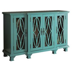Blue-finished+cabinet+with+4+glass-paneled+doors+featuring+geometric+overlay.  +  Product:+CabinetConstruction+Material:+
