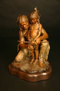 """""""Iron Sharpens Iron"""" is one of more than 30 bronze sculptures by John Coleman on view through September 30, 2015 at Western Spirit: Scottsdale's Museum of the West. The bow and arrow represent food and protection for the whole tribe. As this Plains Indian father mentors his son on how to correctly fit the arrow to the bow, he also ensures the survival and prosperity of his people."""