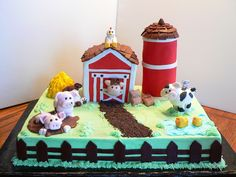 This is my first barnyard cake for a little boy's first birthday.  Thanks to all the inspiring barnyard cakes on CC!!  It took alot longer than I thought it would but I had fun putting it all together.  :D  The barn and the silo are white cake and the 1/2 sheet is choc with ding dong filling.  TFL!