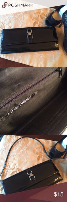 Nine West Black Patented Clutch w Silver Buckle This cute clutch has removable strap, 6 credit card slots & 1  zippered pouch. Great condition Nine West Bags Clutches & Wristlets
