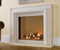 Log effect gas fire Frameless or choice of surrounds Sequential remote control NG or LPG Balanced flue (no chimney required) Manufactured by Gazco Shown: Riva 2 800 log effect balanced flue gas fire with Grafton Limestone surround
