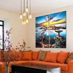 Blue Sky And Sun  Orange sectional  Striped pillows Retro chandelier