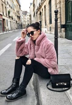 She wears black Loavies's boots, black pants of the brand Zara, black bags of the brand Proenza Schouler, and light pink coats of Loavies
