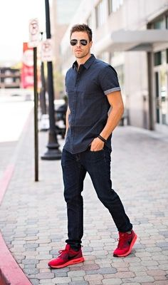 Men's Charcoal Short Sleeve Shirt, Black Skinny Jeans, Red Athletic Shoes, Dark Brown Sunglasses