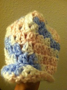 Suoer cute baby hat with a little brim.  It is Blue, White an dPink Variegated! Soft and warm!!!