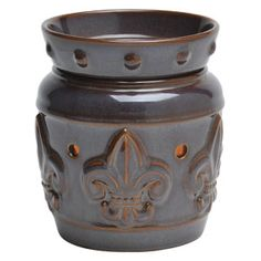 Chateau Mid-Size Scentsy Warmer    Featuring a fleur-de-lis—the enduring symbol of European crests and coats of arms. Antique brown shows through deep purple, accentuating the French feeling of this warmer.
