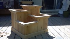 """Strawberry planter I made for Mike's friend. This is just a picture, there is no link. The boxes dimensions from tallest to shortest are as followed 24""""x12"""", 20""""x12"""", 16""""x12"""", and 12""""x12"""".  I used cedar fence posts to construct the boxes and cedar trim (1x3's & 1x2's). The bottom trim is made from 1x4 cedar fence posts."""
