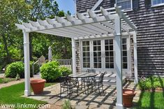 French doors opening to patio with pergola