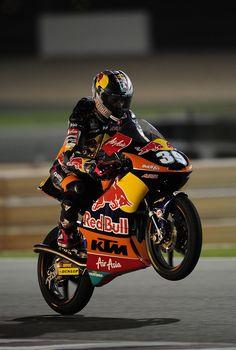 3. Louis Salom wheelies in the darkness of Qatar 2013