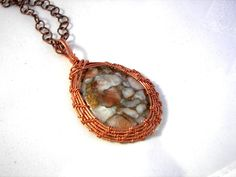 Woven and Wire Wrapped Natural Copper Cabochon Pendant And Necklace. $75.00, via Etsy.
