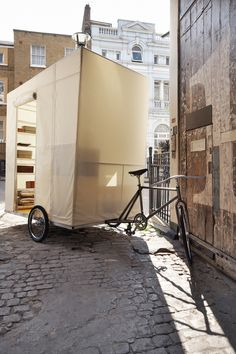"Jacob Strand and ""supertramp,"" a pushbike caravan in London.  Photo by Felicity Crawshaw."