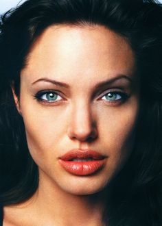 Ahhh, Angelina Jolie. Finally a white girl with huge lips and a semi huge forehead just like me. ;) LOVE HER <3