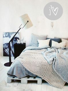Soooo comfy!!! blue and grey bed. crocheted blankets... made out of angora would = the perfect bed.