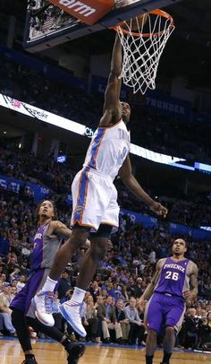 Oklahoma City's Serge Ibaka (9) dunks in front of Phoenix 's Channing Frye (8) and Phoenix 's Shannon Brown during the NBA game between the Oklahoma City Thunder and the Phoenix Suns