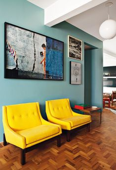 yellow sunshine chairs against soft turquoise blue walls. I'd like the parquet to be lighter or darker though I think