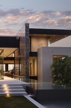 Modern home with lap pool fountain and marble wall