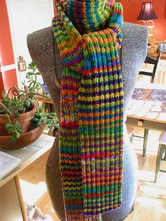 Technicolor Dream Scarf: Simple Rib Pattern alternating between two variegated yarns every two rows....