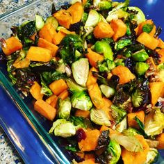 I'm not cooking this year but I made this to bring to my Mom's house. It's SO GOOD!!! Got this off another group and made a couple changes!  Maple roasted brussles with sweet potato, cranberries and pecans!  2 packages of Costco brussels sprouts, cut in half (I cut the big ones twice) 2 pounds cubed sweet potatoes (can use butternut squash too) - cut as small as sprouts  1.5 cups dried cranberries nt.