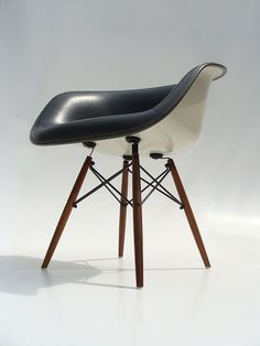 \\ eames white shell chair w/black leather interior and wooden eiffel base