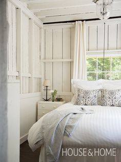 This cottage's all-white bedrooms are perfect for balmy summer living. | Photographer: Maxime Desbiens