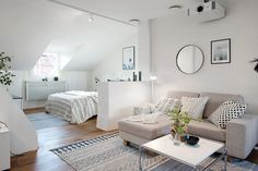 The subtle division between the living room and the bedroom makes this studio . The sophisticated layout between the living room and the bedroom makes this attic apartment, with a 50 m² area in Sweden, a space … Studio Apartment Design, Small Apartment Design, Studio Apartment Decorating, Tiny Studio Apartments, One Room Apartment, Apartment Interior, Apartment Living, Attic Bedroom Small, Attic Bedroom Designs