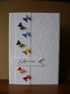 Tiny colourful butterflies on a white background - try other origami 3D models as well..