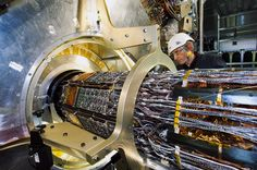 "Images from the construction of ""the massive $4-billion-dollar machine that allowed us peer so closely into the subatomic world."" (©2012 CERN)"