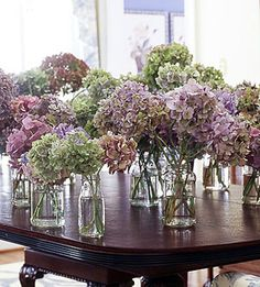 I think we should do the blue and white hydrangeas in different sized mason jars. nice and simple, yet really pretty.