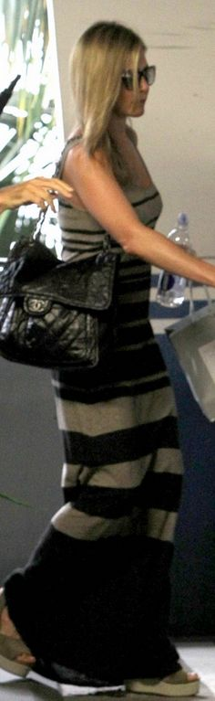Who made Jennifer Aniston's wedge sandals, black quilted handbag, black sunglasses, and tan stripe maxi dress that she wore in Hollywood on August 9, 2013? Shoes – Pedro Garcia  Sunglasses – Oliver Peoples  Purse – Chanel  Dress – Vince