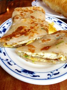 "Egg Roll (""dan bing"") a soft green scallion pancake with a fried egg."