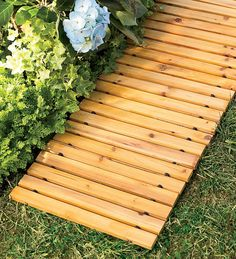 Roll out this 8'L Cedar Pathway for a raised and dry pathway in your garden, damp areas or muddy ground.