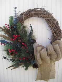Christmas Wreath with Burlap Rustic and Natural with by ATPitman, $53.00 The wreath showcases a variety of rustic tree stems, pinecones, feathers, red berries and eucalyptus . The finishing touch is a beautiful burlap bow! This wreath measures approximately 20 inches across and is formed on a grapevine base with artificial stems.