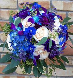 Wedding Bouquet Arranged With: Light Creamy Blush Roses, Blue Hydrangea, Blue Delphinium, Blue/Purple Dendrobium Orchids, Purple Caspia & Green Seeded Eucalyptus