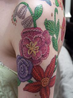 unknown; Deluxe Tattoo, Chicago IL USA. that is a design i can get behind. | craft knit flower  http://www.flickr.com/photos/29658166@N07/4402295959/ http://www.flickr.com/photos/29658166@N07/4301427327/