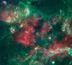Cygnus-X (A nearby star factory): Taken in 2009 by th eorbiting Spitzer Space Telescope and digitally translated into colors humans can see.