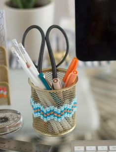 add a little warmth to your office supply stash - cross stitch on the metal-grid style containers