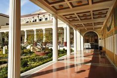 Photograph:The Getty Villa in Malibu, Calif., -- a colonnade around a central garden inspired by a Roman villa.