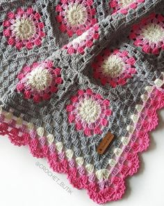Granny square blanket colour scheme in pink, white and grey.
