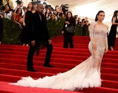 So American royalty Kim Kardashian showed up to this year's Met Gala looking like this in Roberto Cavalli: