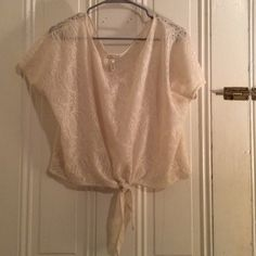Crocheted short sleeve tied bottom top Sheer crocheted/lace short sleeve top with tie detail at bottom. Perfect with tank or bralette underneath. From PacSun Kirra Tops Blouses