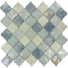 """There are dozens of shades of blue that appear when you look into water, and this heavenly lagoon blue glass tile attempts to showcase all of them. The graceful arabesque tiles, which are 2"""" by 2 ¼"""", are the perfect complement to any kitchen or bathroom. Though the design is unique, it fits together to form a seamless whole that you'll be proud to display as a backsplash, accent wall, or any other tiled design. At ¼"""" thick, each tile is heavy and durable with a color that will shine through…"""