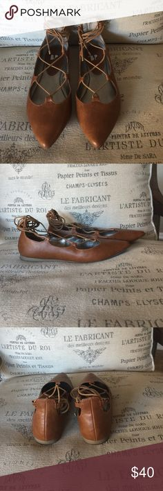 Brown Lace Up Ballerina Brown lace up Ballerina, once worn ( are in perfect condition) very comfortable!! bp Shoes Flats & Loafers