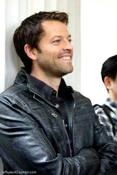 Misha smiles