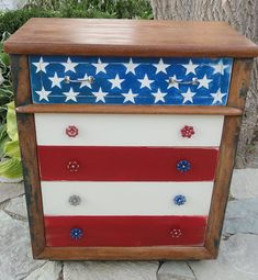 the dresser has an Americana look with its stars and stripes, and had cute little spigot handles for drawer pulls.  What a great use for colorful spigot handles!