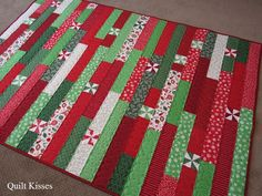 Welcome to day four of Christmas Week here at Quilt Kisses. Today I am sharing the Christmas Race quilt I made with the scraps and lefto. Jellyroll Quilts, Lap Quilts, Strip Quilts, Scrappy Quilts, Quilt Blocks, Christmas Quilt Patterns, Christmas Sewing, Christmas Quilting Projects, Christmas Squares